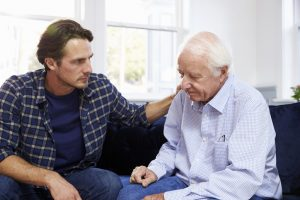 senior home care Phoenix  son with senior father looking depressed