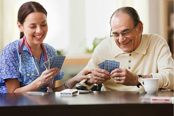 Caregiver and client playing cards