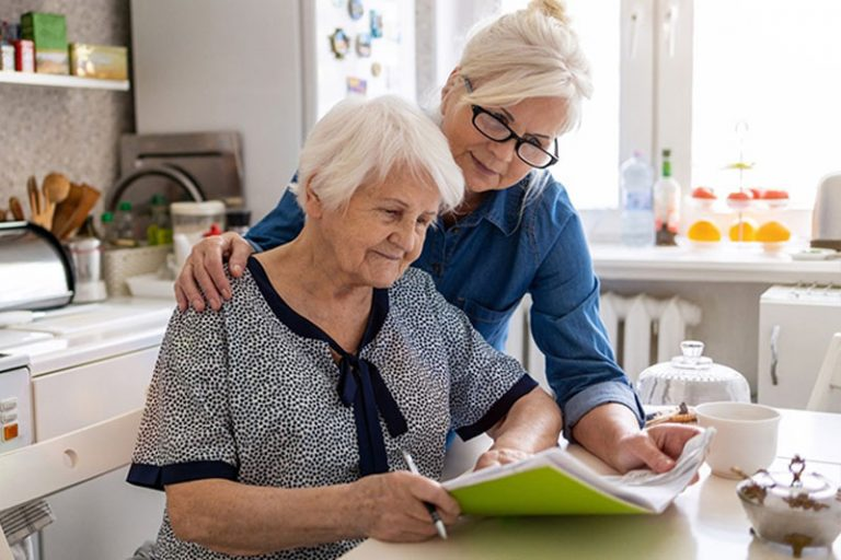 caregiver assisting independence in senior woman