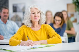 senior woman learning at meeting